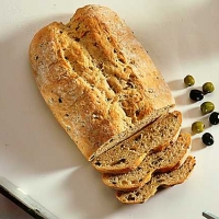 Image of Anchovies And Lemon On Black Olive Bread Recipe, Group Recipes
