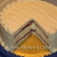 Classic White Layer Cake With Butter Frosting And Raspberry Almond